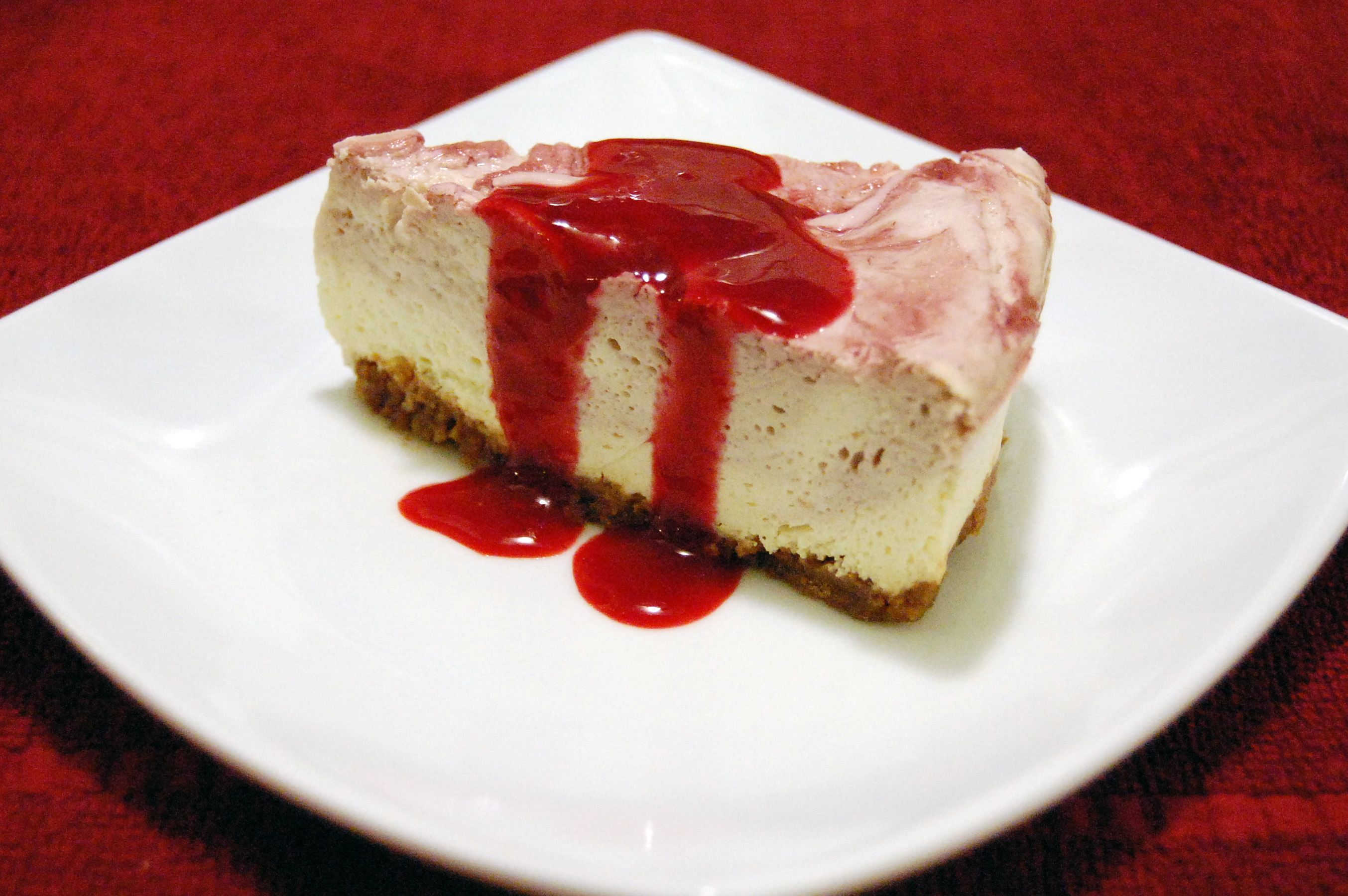 Raspberry Swirl Cheesecake w/ Gingerbread Crust